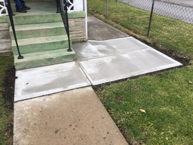 Repaired sidewalk was once crumbling.