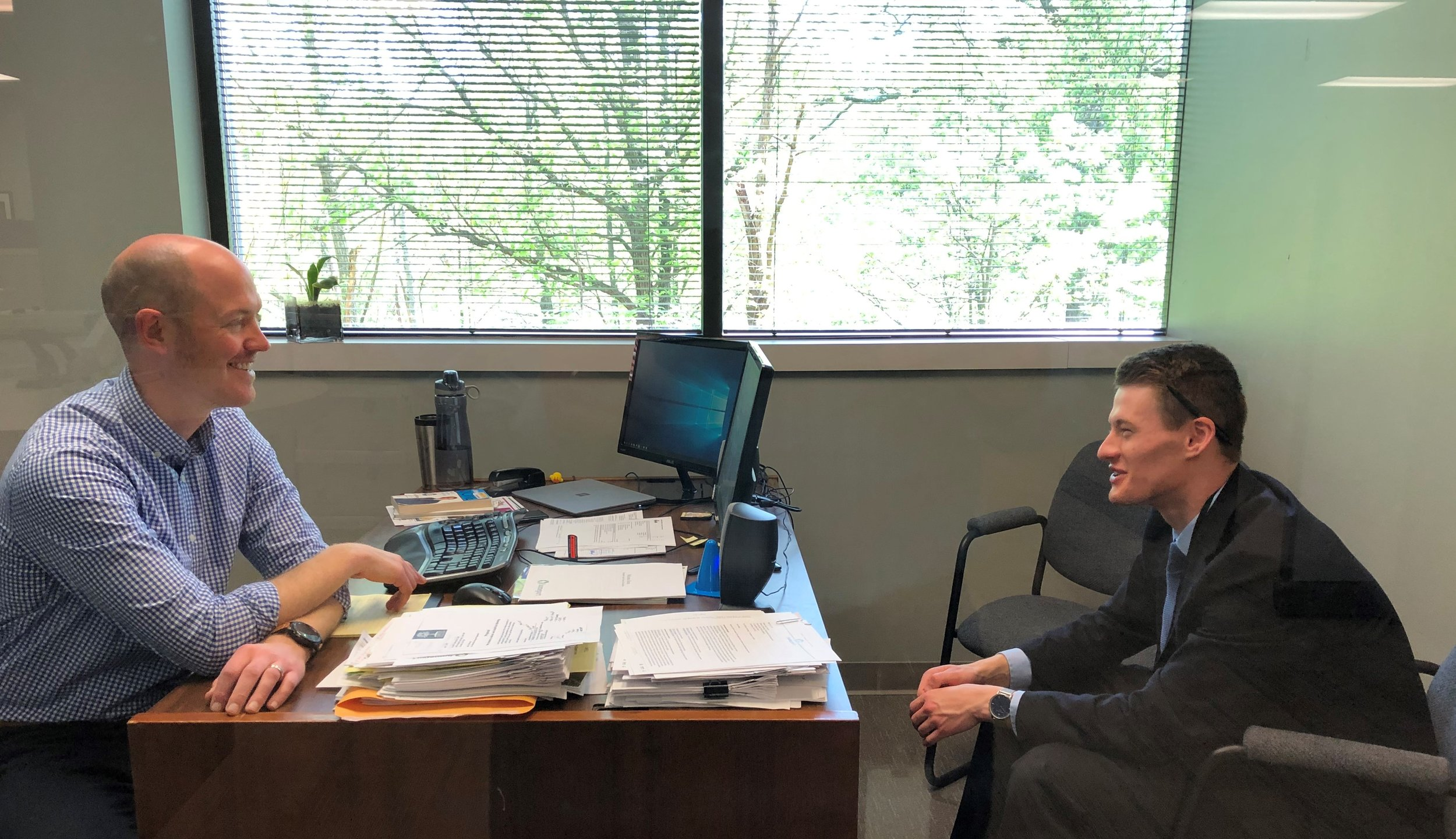 Homeport Project Manager Justin Metzler, left, and with Real Estate Intern Zack Hadley