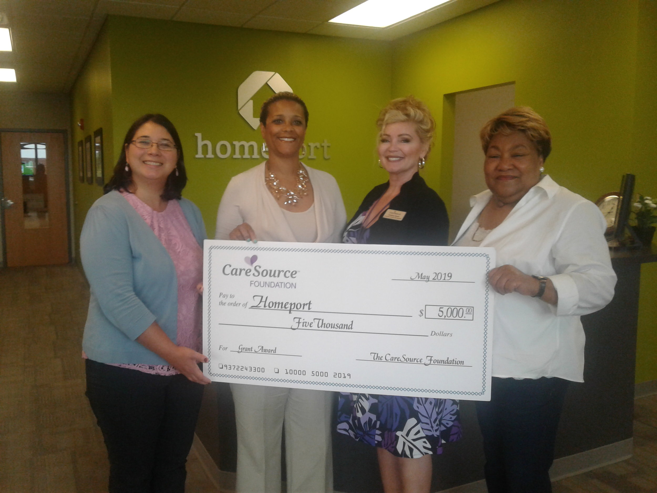 CareSource Foundation Community Education Representative Candice Byers, second from right, delivered a $5,000 grant to Homeport in June.