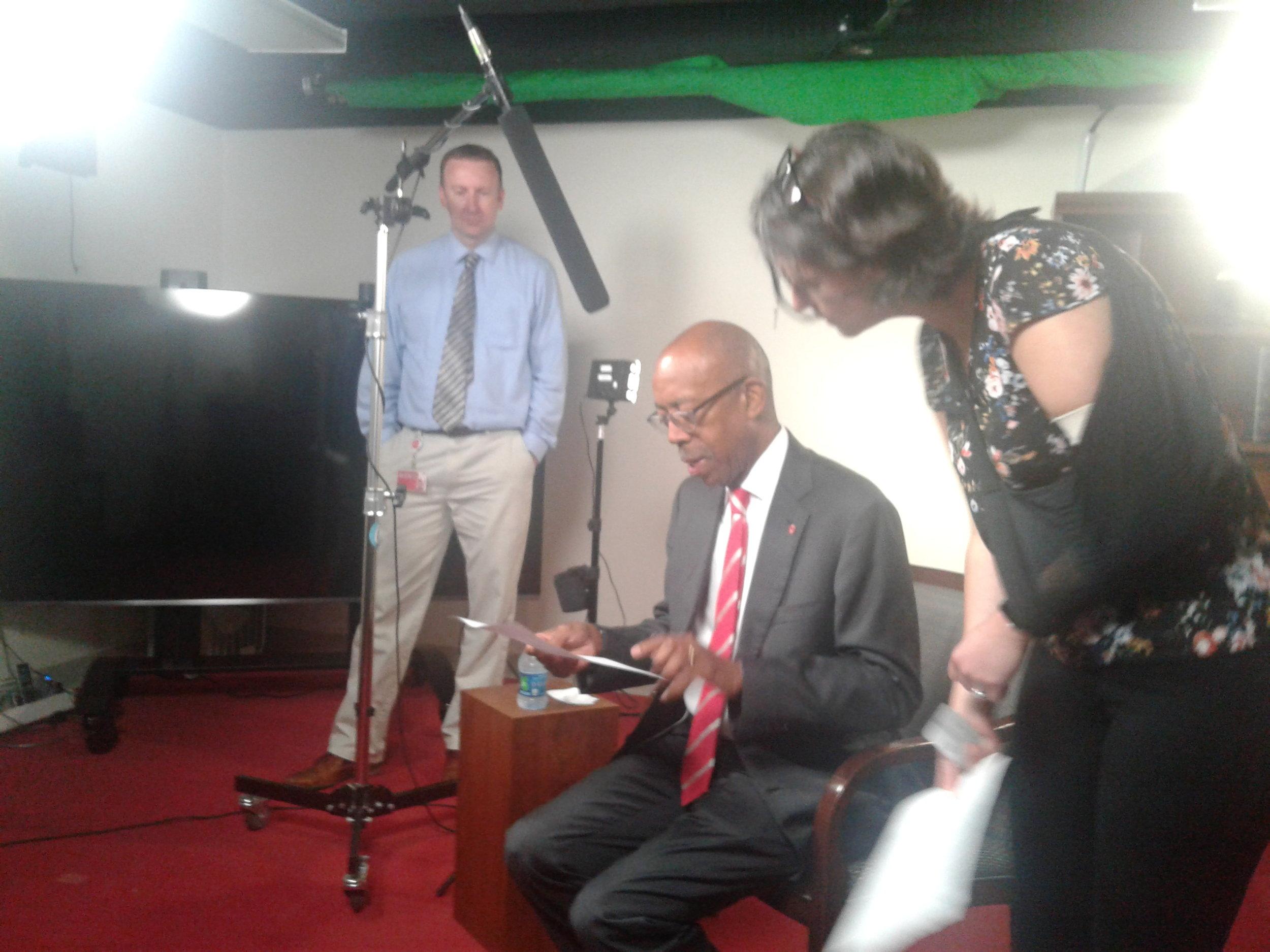 The Ohio State University President Dr. Michael V. Drake, center, prepares for 'Voice & Vision' video shoot.