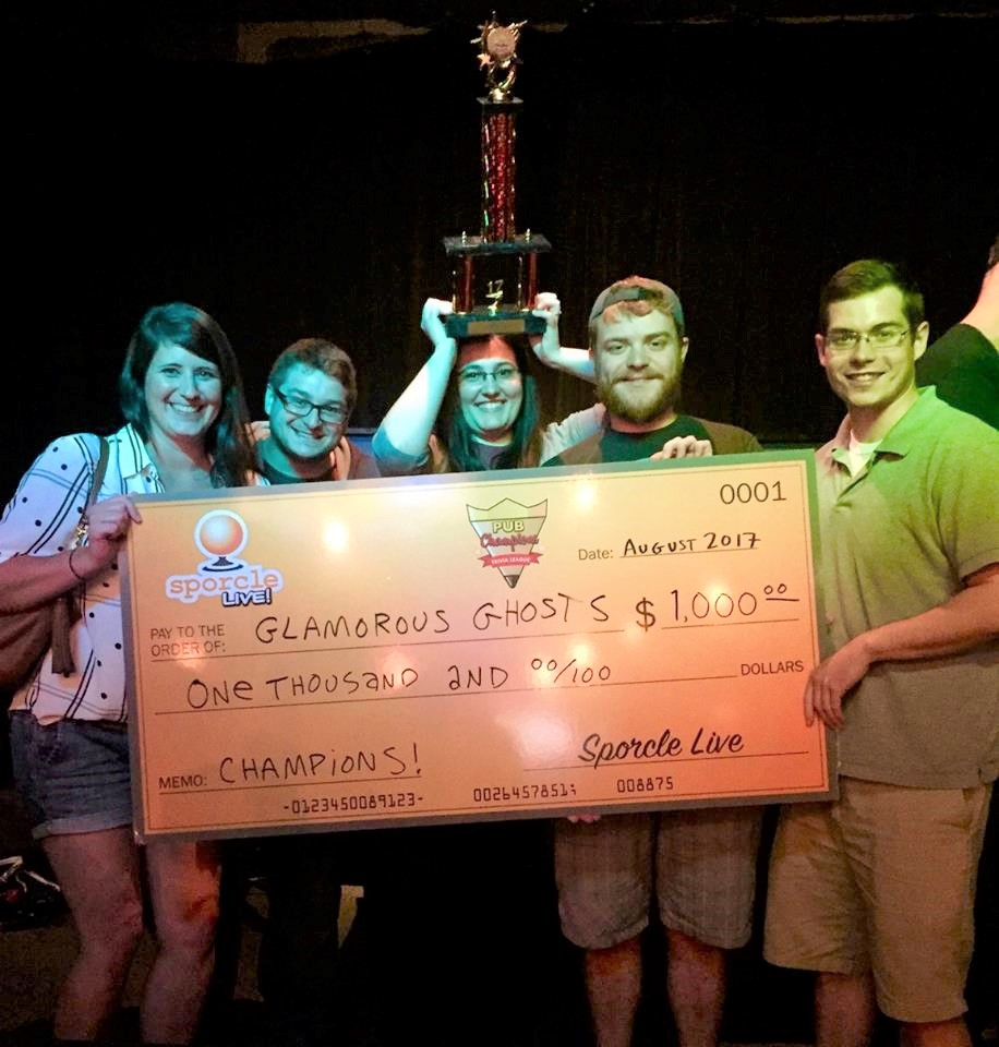 Ryan Manton, second from right, and champion trivia team.