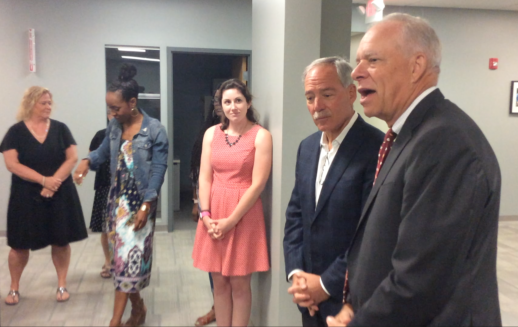 Homeport President & CEO Bruce Luecke, right, introduced Robert Schottenstein to Homeport staff.