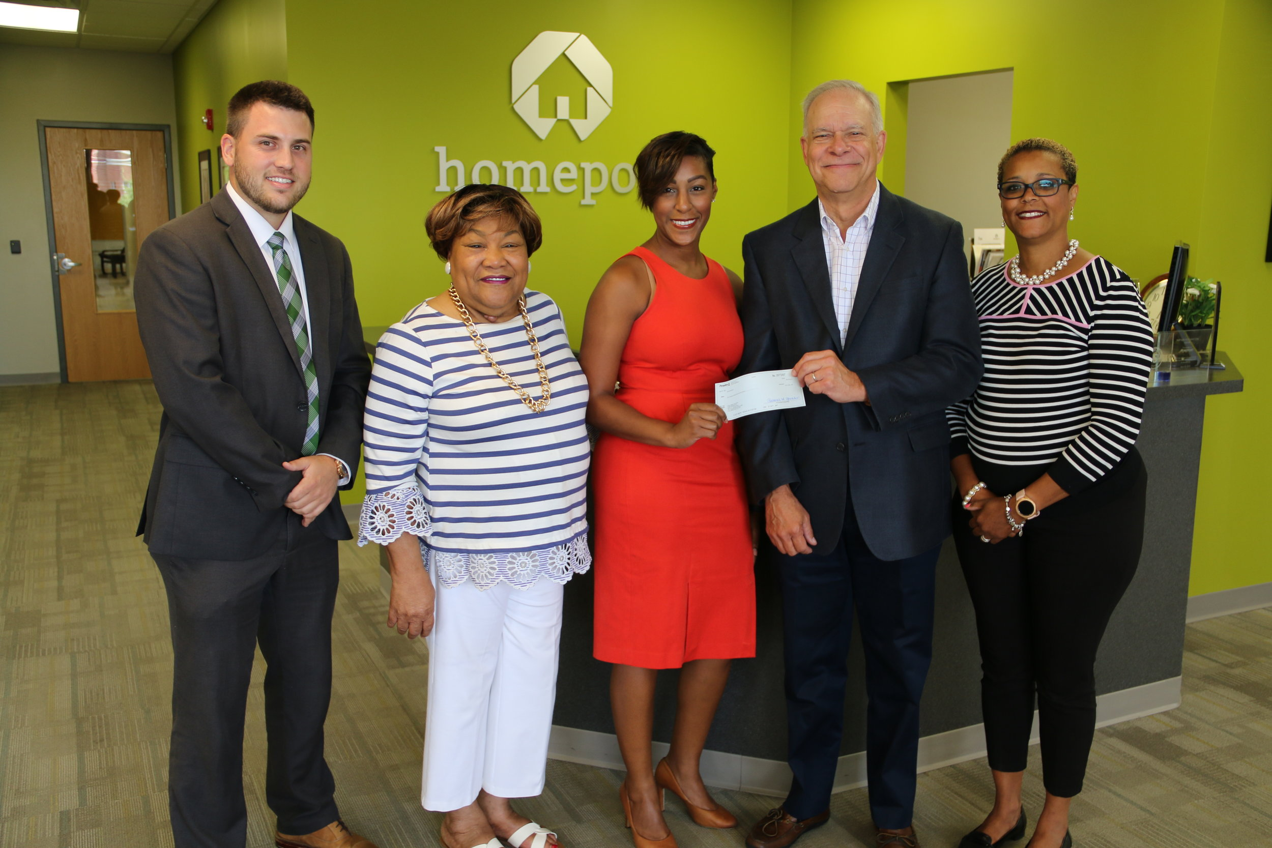 Peoples Bank Banker Justin Kidd, left, and Peoples Vice President Dawn Carpenter, center, presented Homeport with a $10,000 grant for homebuyer edcuation classes. Accepting the donation on behalf of Homeport were Maude Hill, Bruce Luecke and Laverne Price.