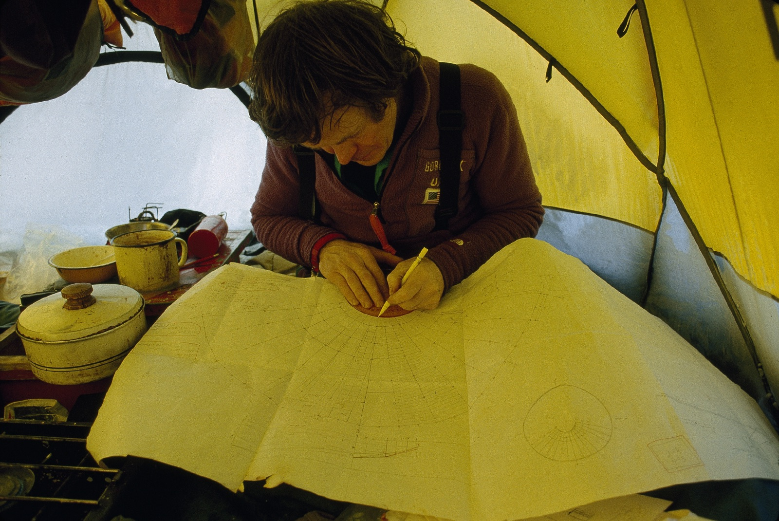 Will Steger plotting route in Trans-Antarctica tent. ©Trans-Antarctica Photo by Per Breiehagen