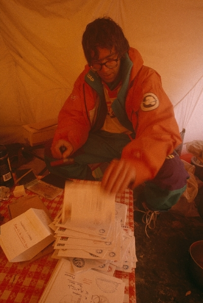 Christian de Marliave (Criquet) stamps letters for friends and sponsors with a South Pole stamp. Photo © Will Steger