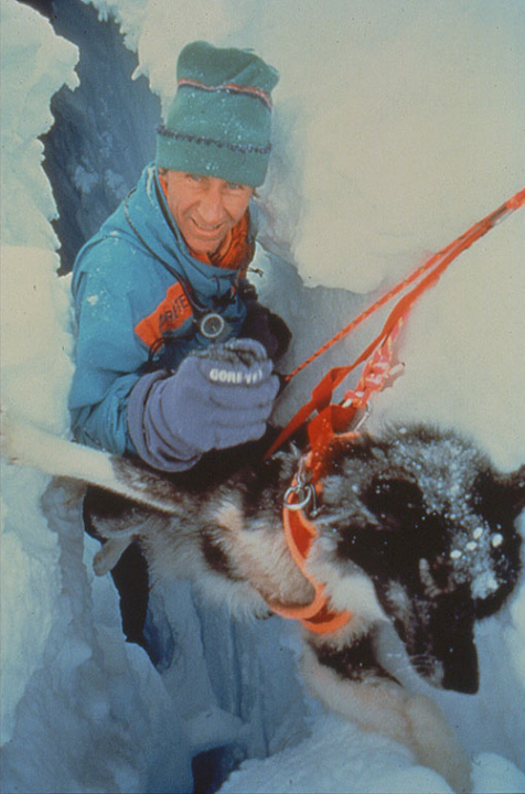 Geoff Somers rescues his dog Huckfrom deep crevasse. Photo © Will Steger