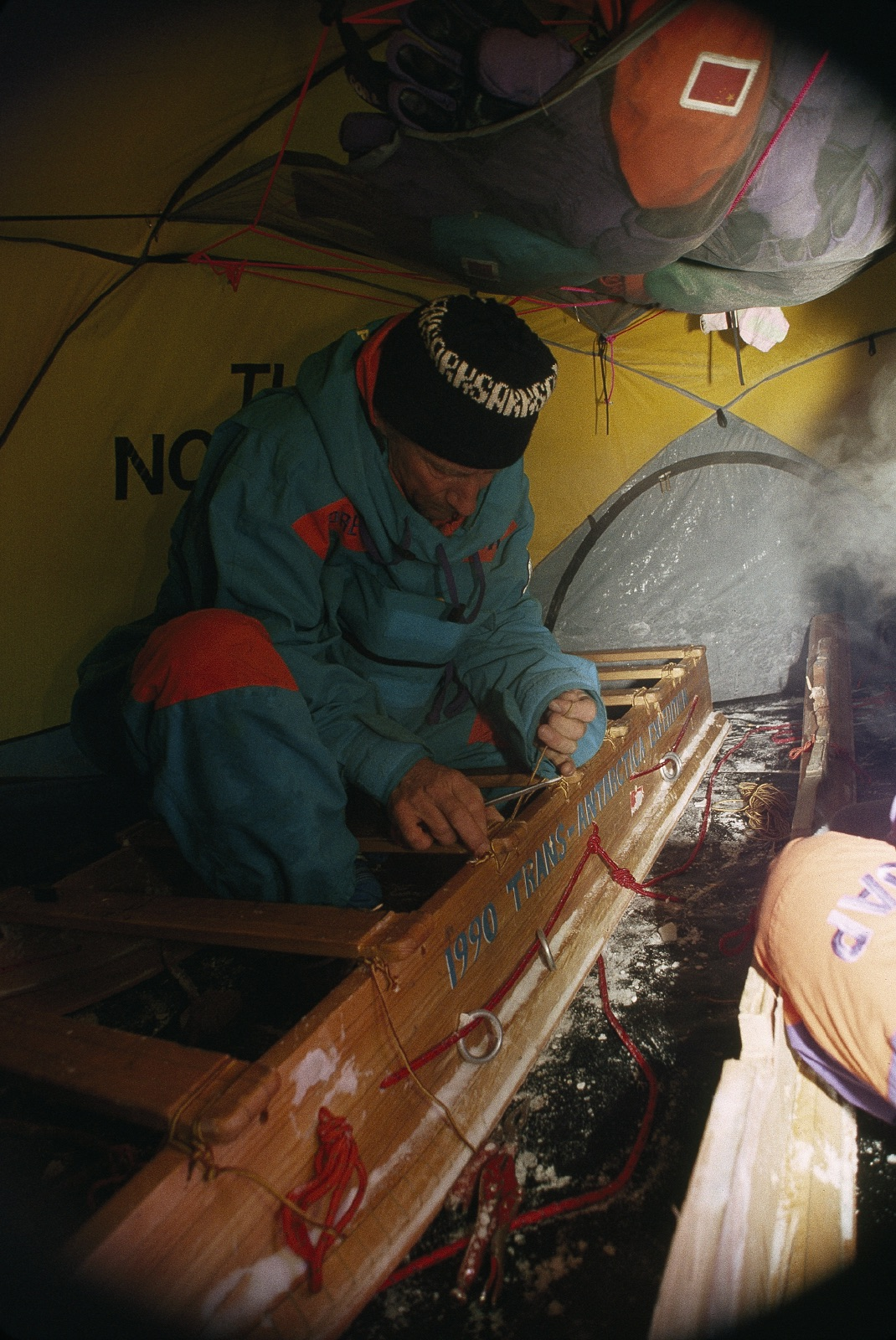 Repairing a sled indoors. Photo © Will Steger.