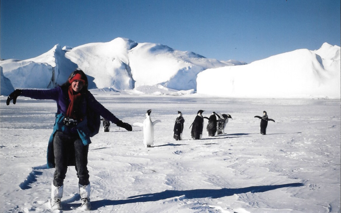 Jacqui Banaszynski playing with penguins at Mirnyy, March 1990. Photo: Bob Picard