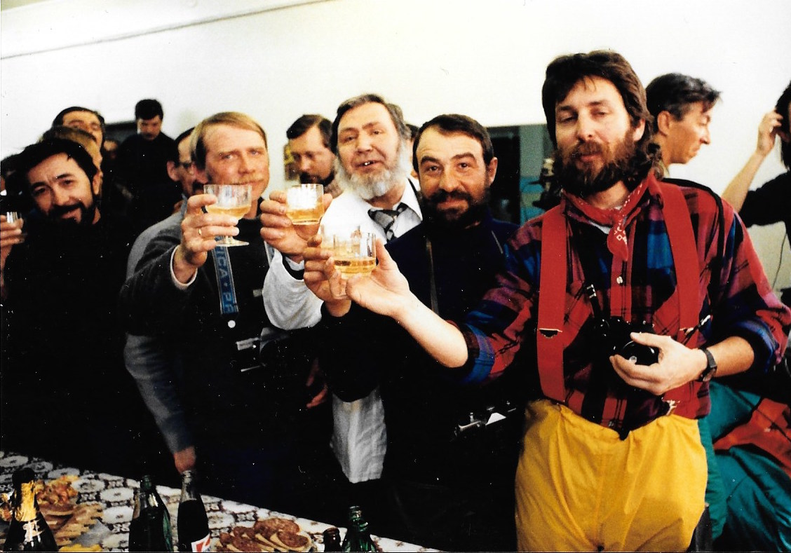 Bob Picard (right) leads the Soviet crew at Mirnyy scientific station in a toast to Jacqui, March 1990. Photo: Jacqui Banaszynski