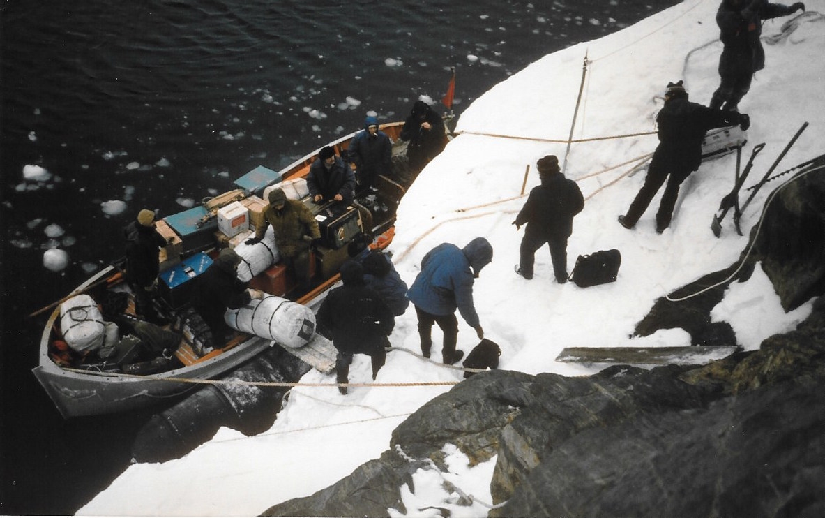 Trans-Antarctica expedition, dogs and gear were lowered down the cliff onto a small boat to be ferried out to the ship that waited beyond the harbor. ©Trans-Antarctica Photo by Per Breiehagen