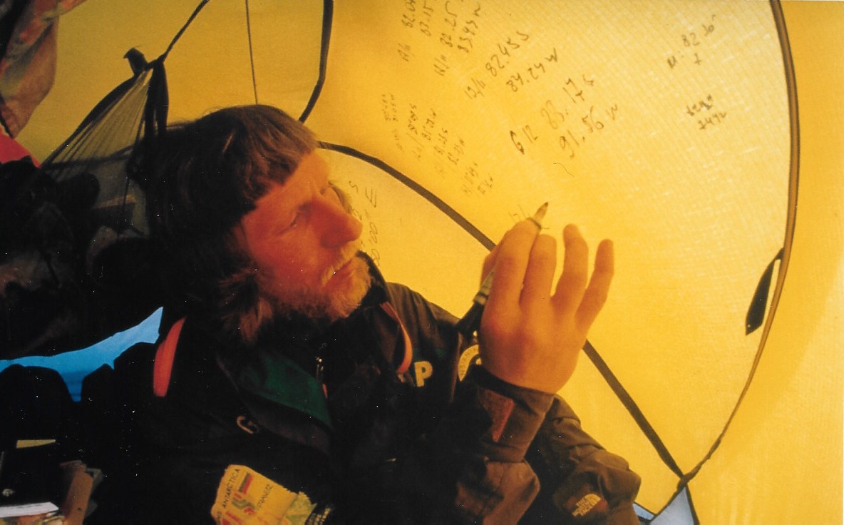 Victor Boyarsky tracks the expedition's position on the tent wall. ©Will Steger, photo by Gordon Wiltsie