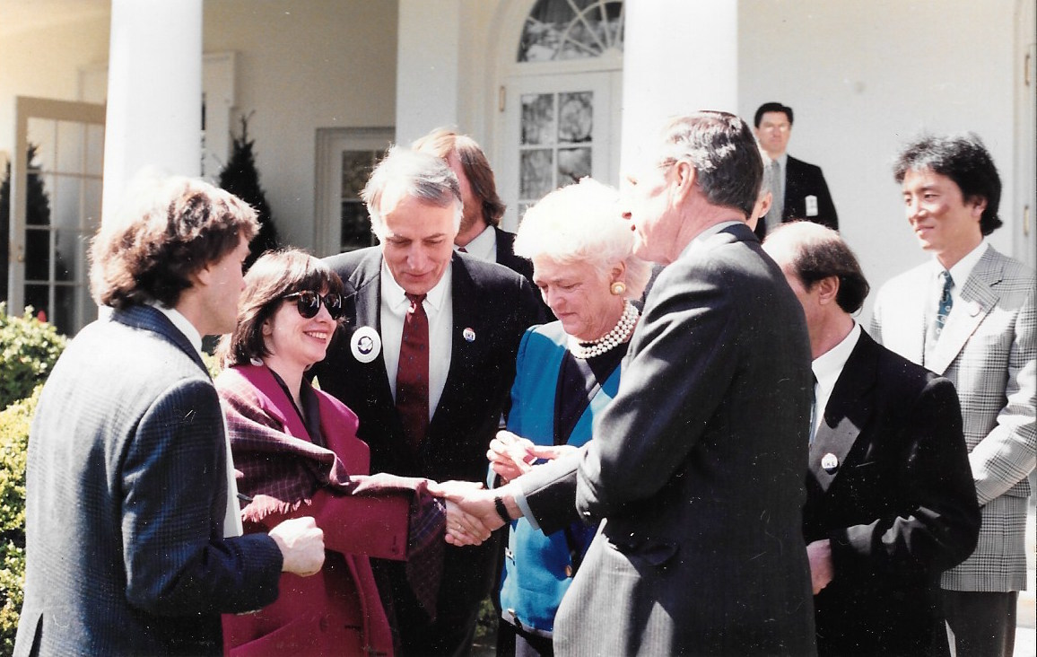 The International Trans-Antarctica Expedition meets President Bush on in the White House Rose Garden. From Left: Will Steger, Cathy de Moll, Senator Dave Durenberger, First Lady Barbara Bush, President George Bush. Behind: Victor Boyarsky, Jean-Louis Etienne and Keizo Funatsu. March 1990. Photo: Ed Garvey