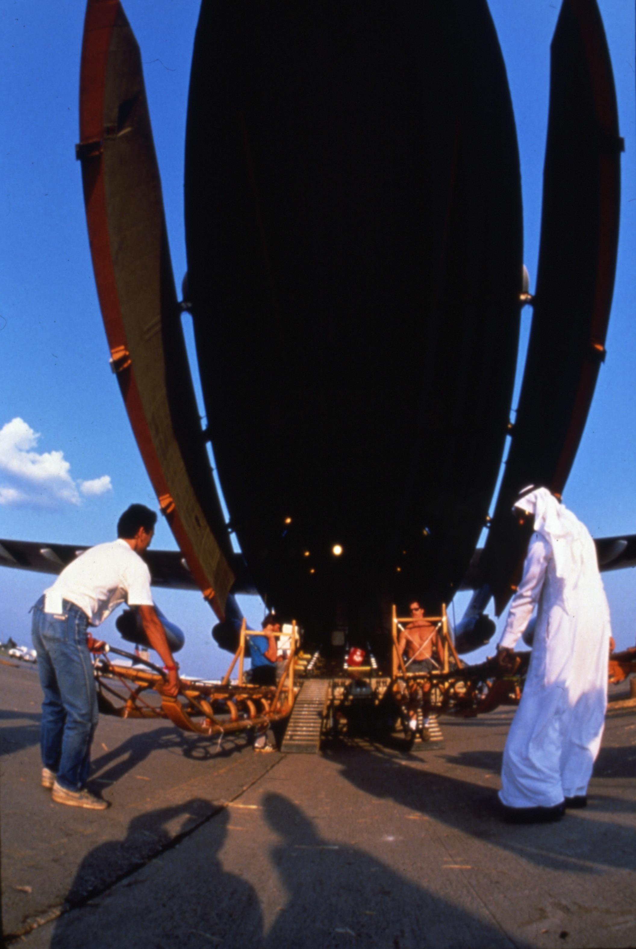 Trans-Antarctica sleds are loaded onto the Soviet's Illyushin 76 in Minneapolis, July 16, 1989. From left, Keizo Funatsu, John Stetson, Ibrahim Alam. Photo © Will Steger.