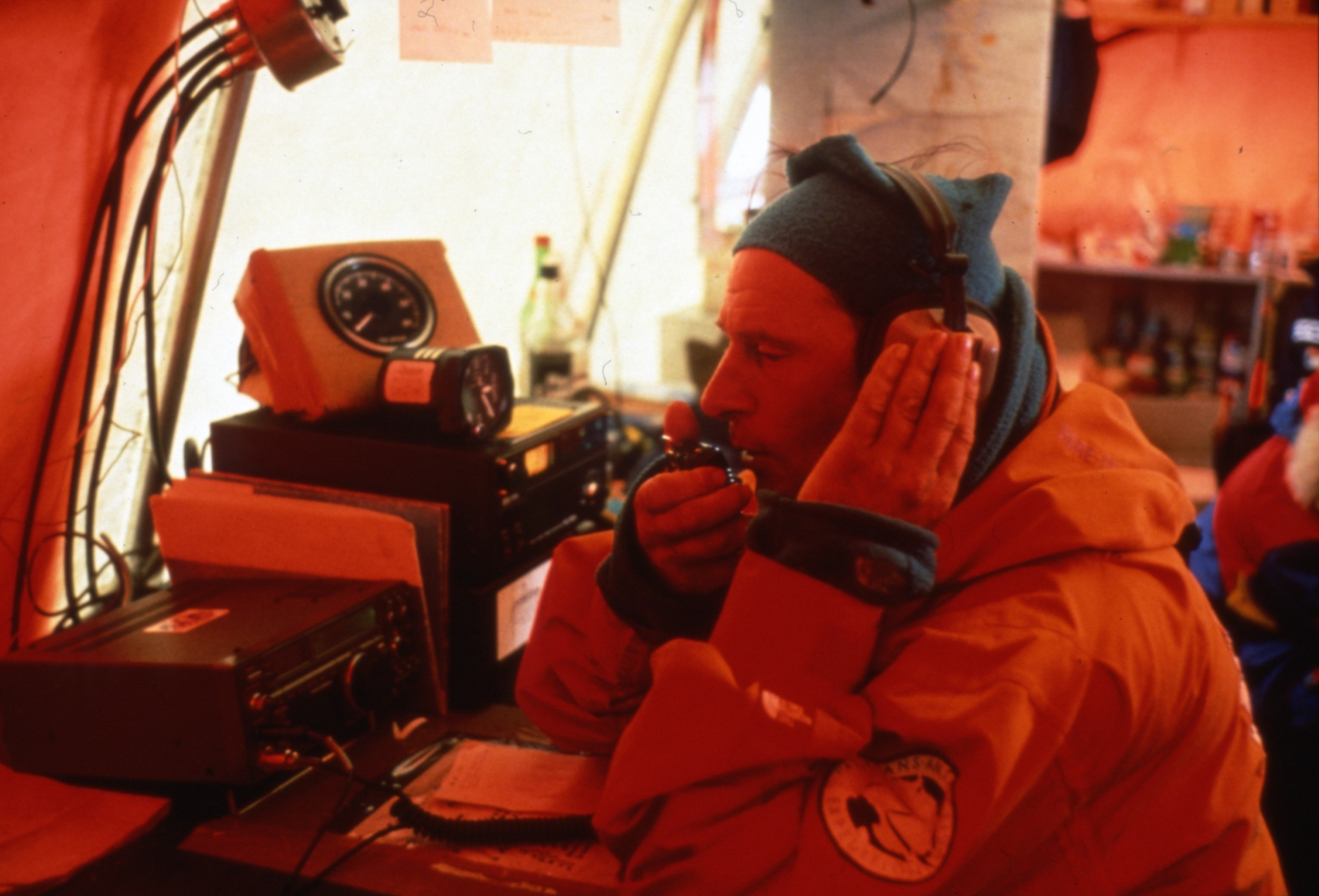 Jean-Louis Etienne takes advantage of the Patriot Hills base camp radio to discuss failing logistics with Criquet and Cathy. Photo © Will Steger
