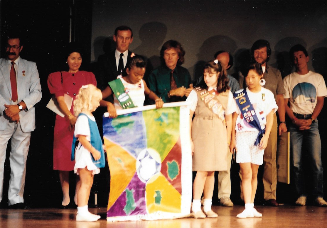 Students present the team a Trans-Antarctica poster,March 1990. Photo: Jack Dougherty