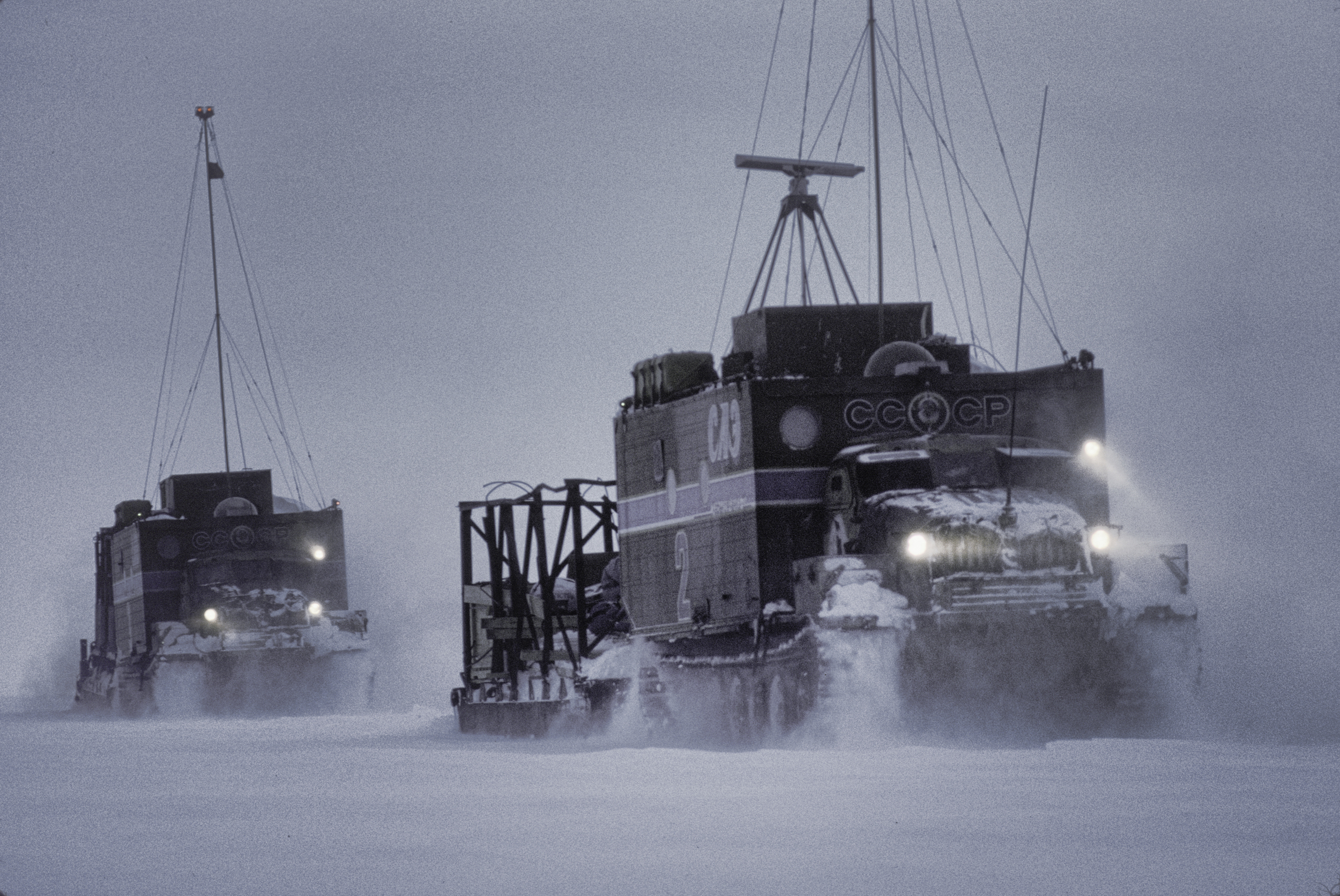 Large tractors (trax) rode 50 miles ahead of the Trans-Antartica Expedition and laid caches for the team through the Soviet zone of influence. ©Trans-Antarctica Photo by Per Breiehagen