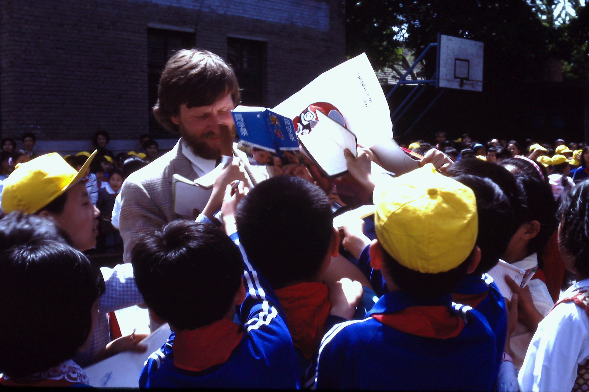 Trans-Antarctica team member Victor Boyarsky signs autographs in a Beijing schoolyard, May 1990. Photo: Cynthia Mueller.