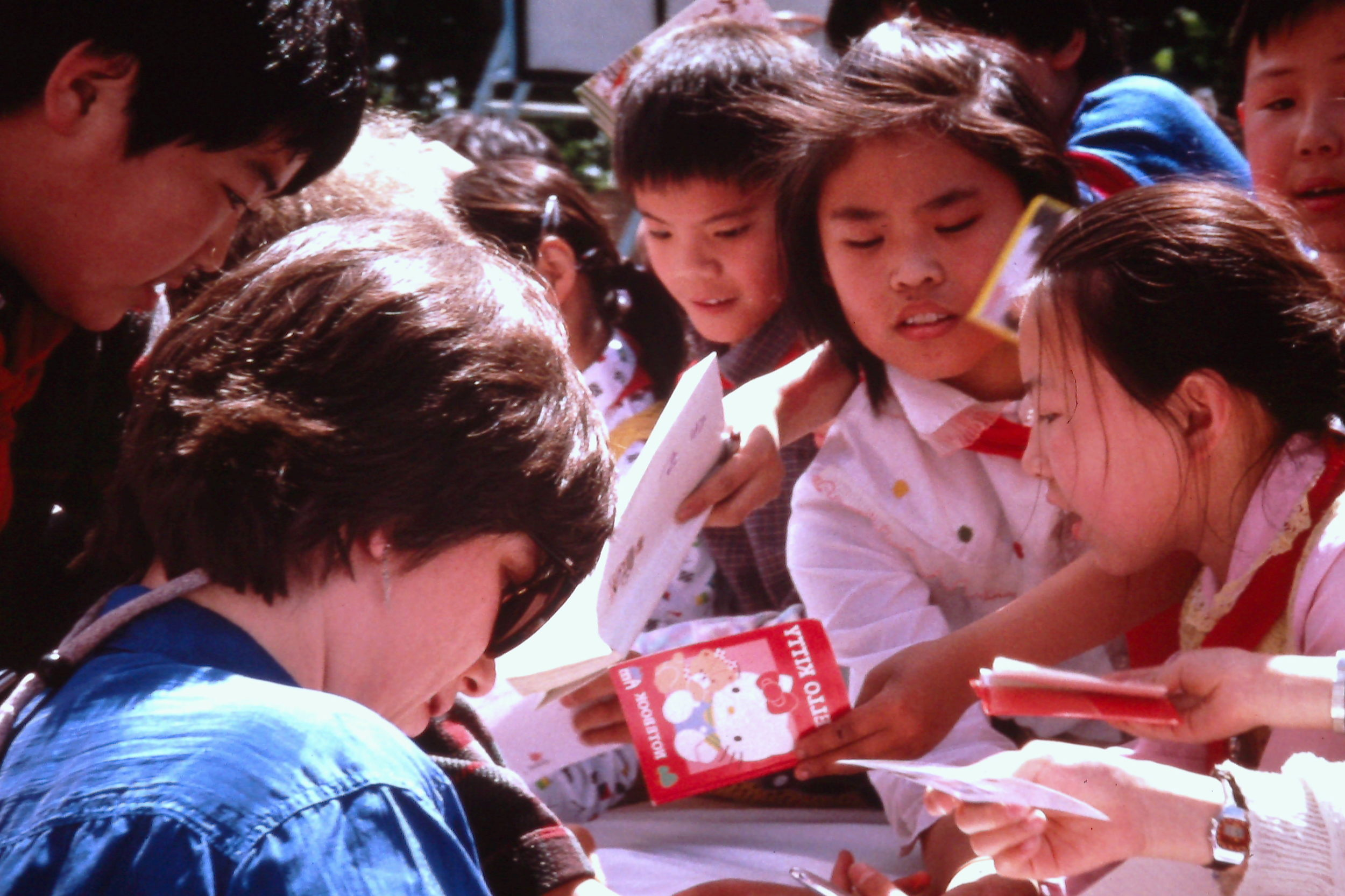 Students swarm the author for autographs,Beijing, China, May 1990. Photo: Cynthia Mueller
