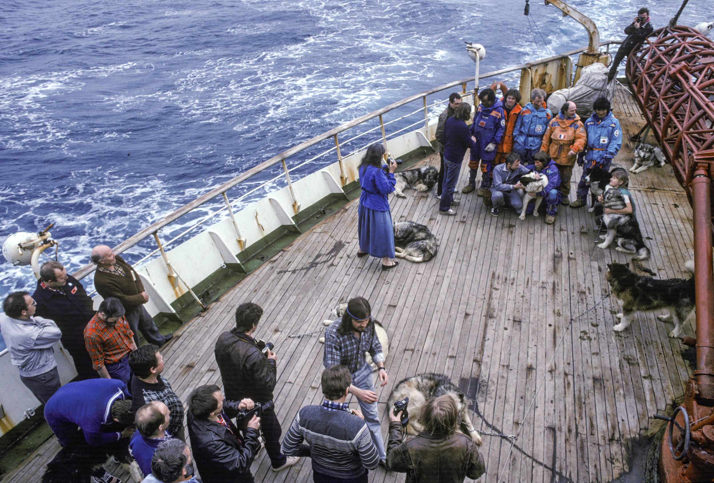 Out in the Indian Ocean, Jacqui takes photos of the team, March 1990 ©Trans-Antarctica photo by Per Breiehagen
