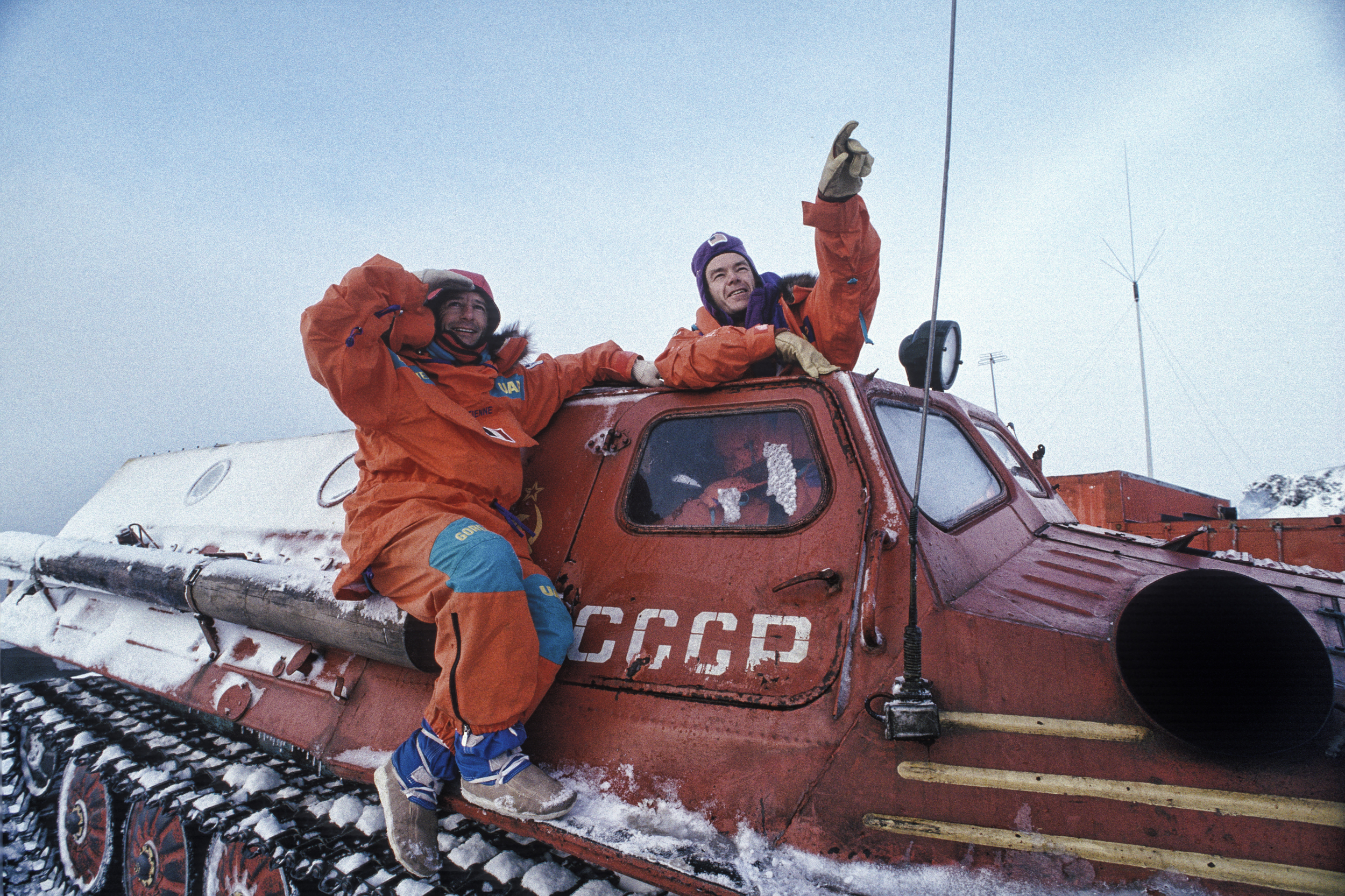Jean-Louis Etienne and Will Steger riding in the ancient Soviet tanks that were their transport on King George Island. ©Trans-Antarctica photo by Per Breiehagen