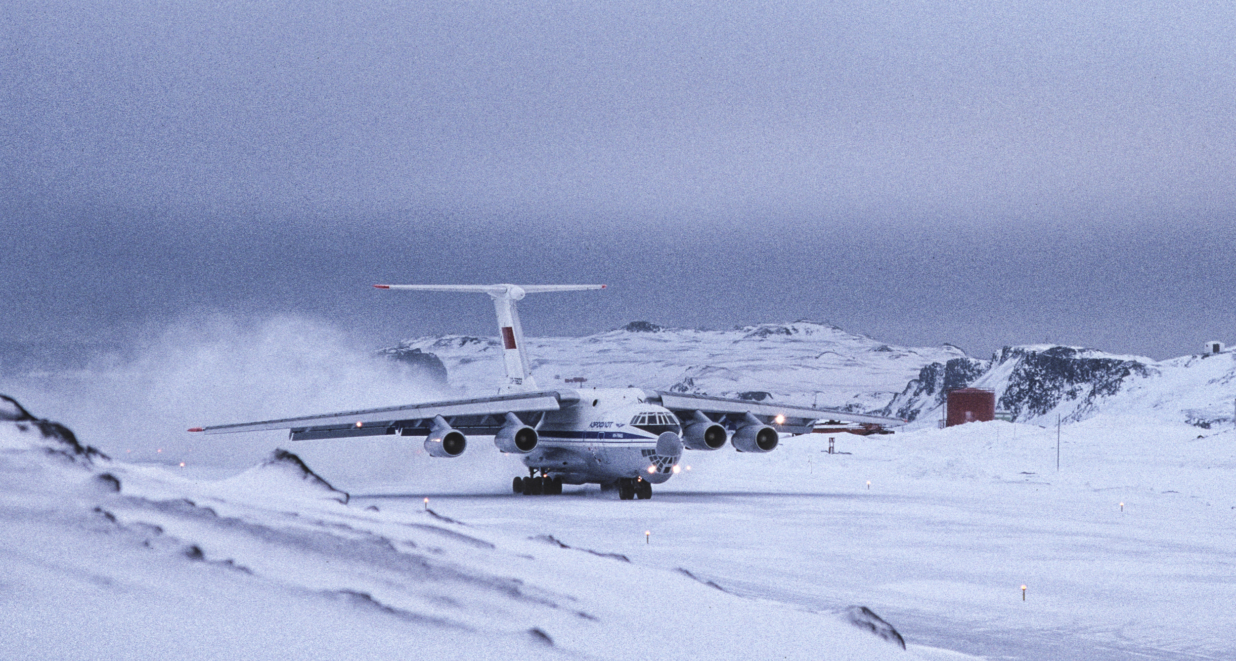 The Soviet Illyushin 76 takes off from King George Island, July 1989.  ©Trans-Antarctica photo by Per Breiehagen