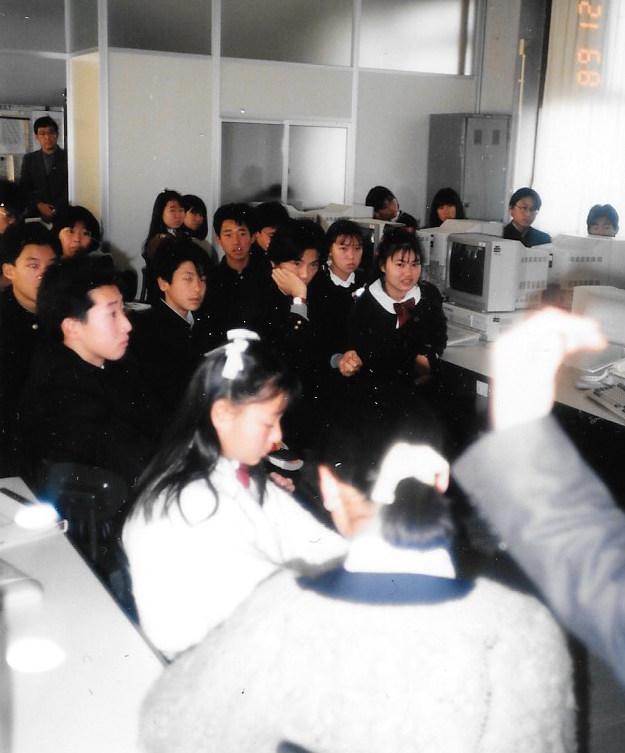 Nara, Japan students listen to an update on the Trans-Antarctica Expedition,November 1989.Photo: Yukio Kondo