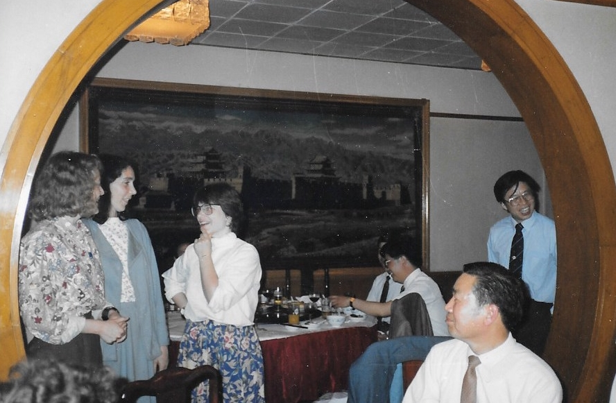 """Mr. Li convinces Jennifer, Cynthia and Cathy to sing """"My Favorite Things"""" in-between courses at a Trans-Antarctica event. Beijing, China, May1990. Photographer: Unknown."""