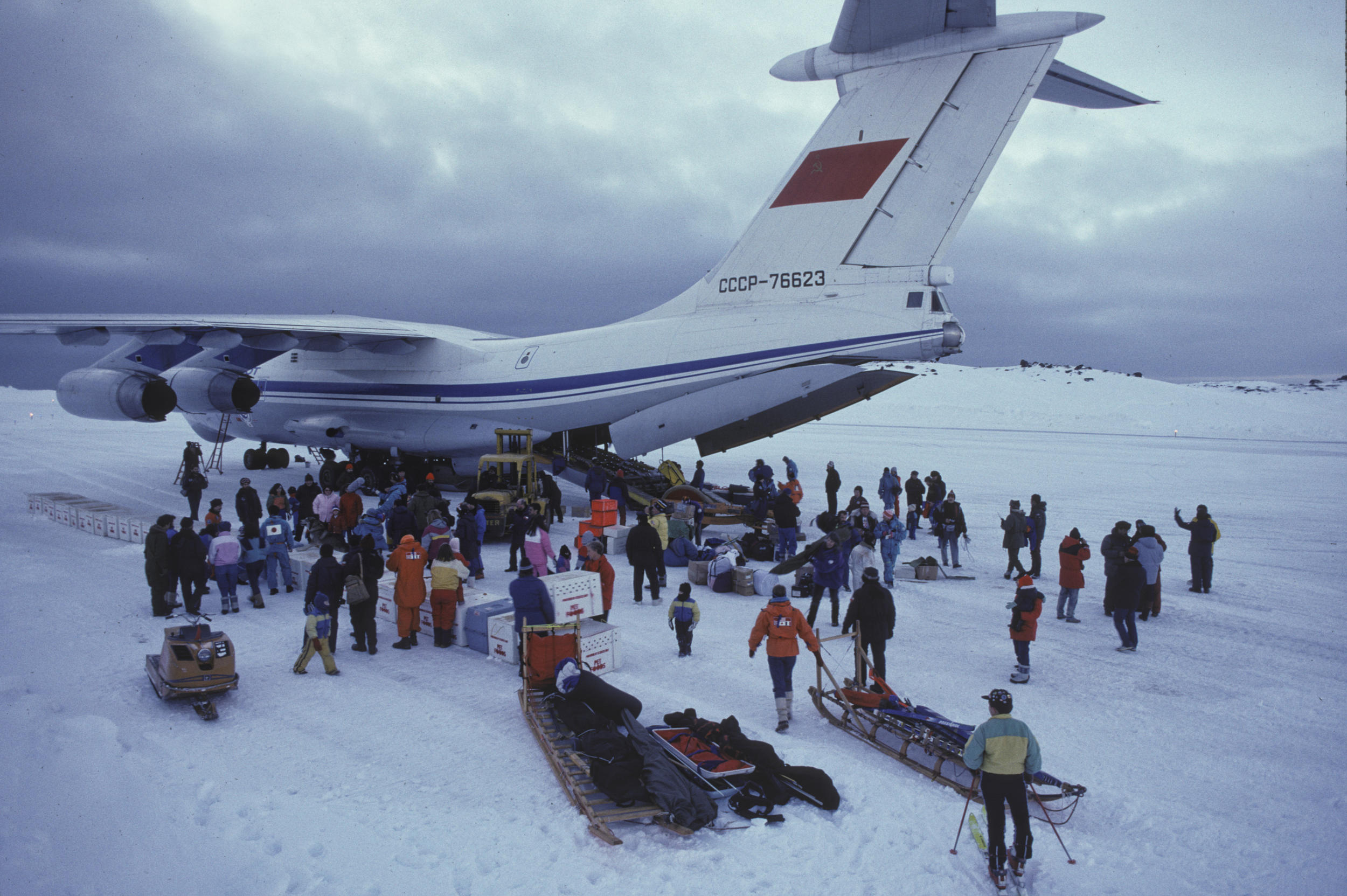 King George Island residents gather to watch the expedition unload the Illyushin 76. July 1989. ©Trans-Antarctica, photo by Per Breiehagen