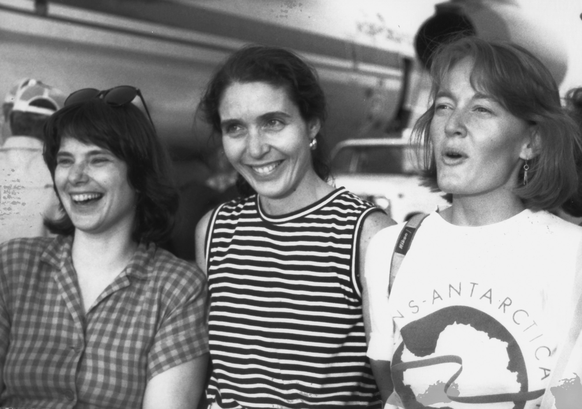 Cathy de Moll, Cynthia Mueller and Jennifer Gasperini on the Minneapolis tarmac as the Illuyshin prepares to leave for Antarctica. July 16, 1989. Photographer unknown.