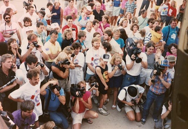 Friends and family watch last-minute loading of the plane, July 16, 1989. Photo: Jennifer Gasperini