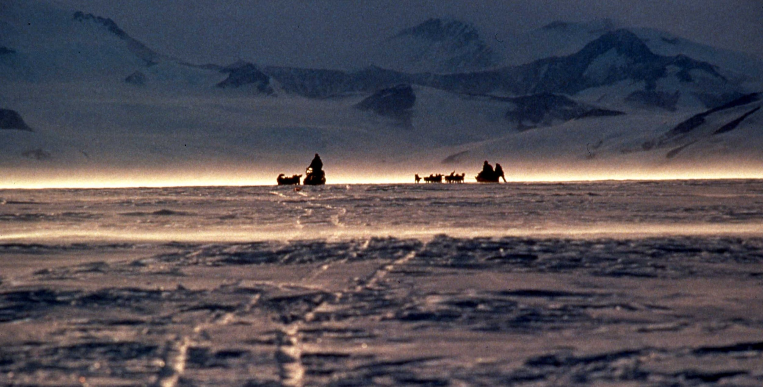 1990 International Trans-Antarctica Expedition heads from the Larsen Ice Shelf to the mountains on the Antarctic Peninsula. ©Will Steger by Rick Ridgeway