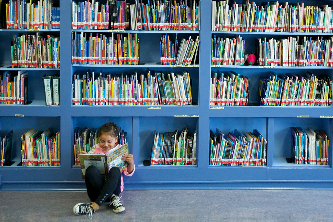 Girl reading in library.jpg