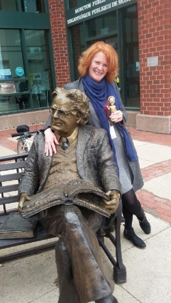 "Carol McDougall chats with Northrop Frye while holding her ""Norrie"" award"