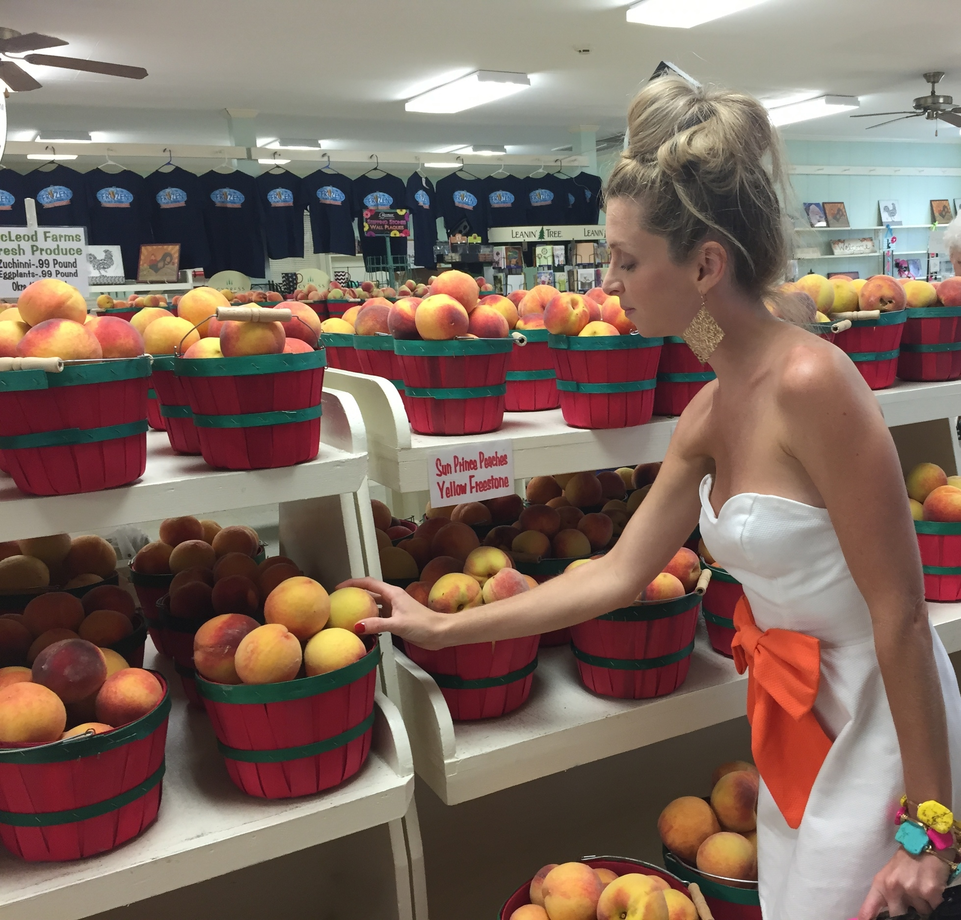 Picking out the juiciest peach at McLeod Farms in McBee, SC.