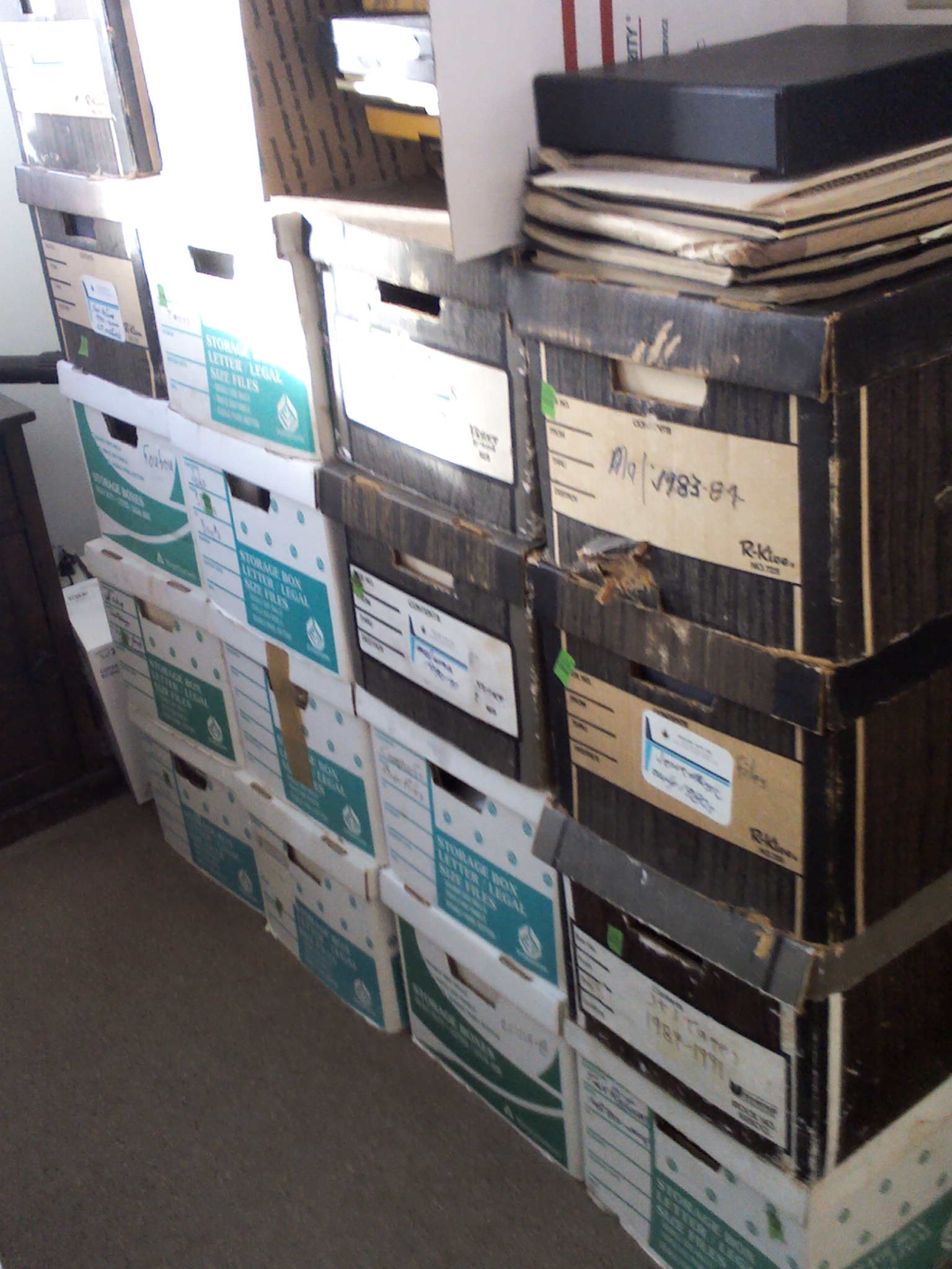 Archive boxes in Jerré's bedroom awaiting sorting.