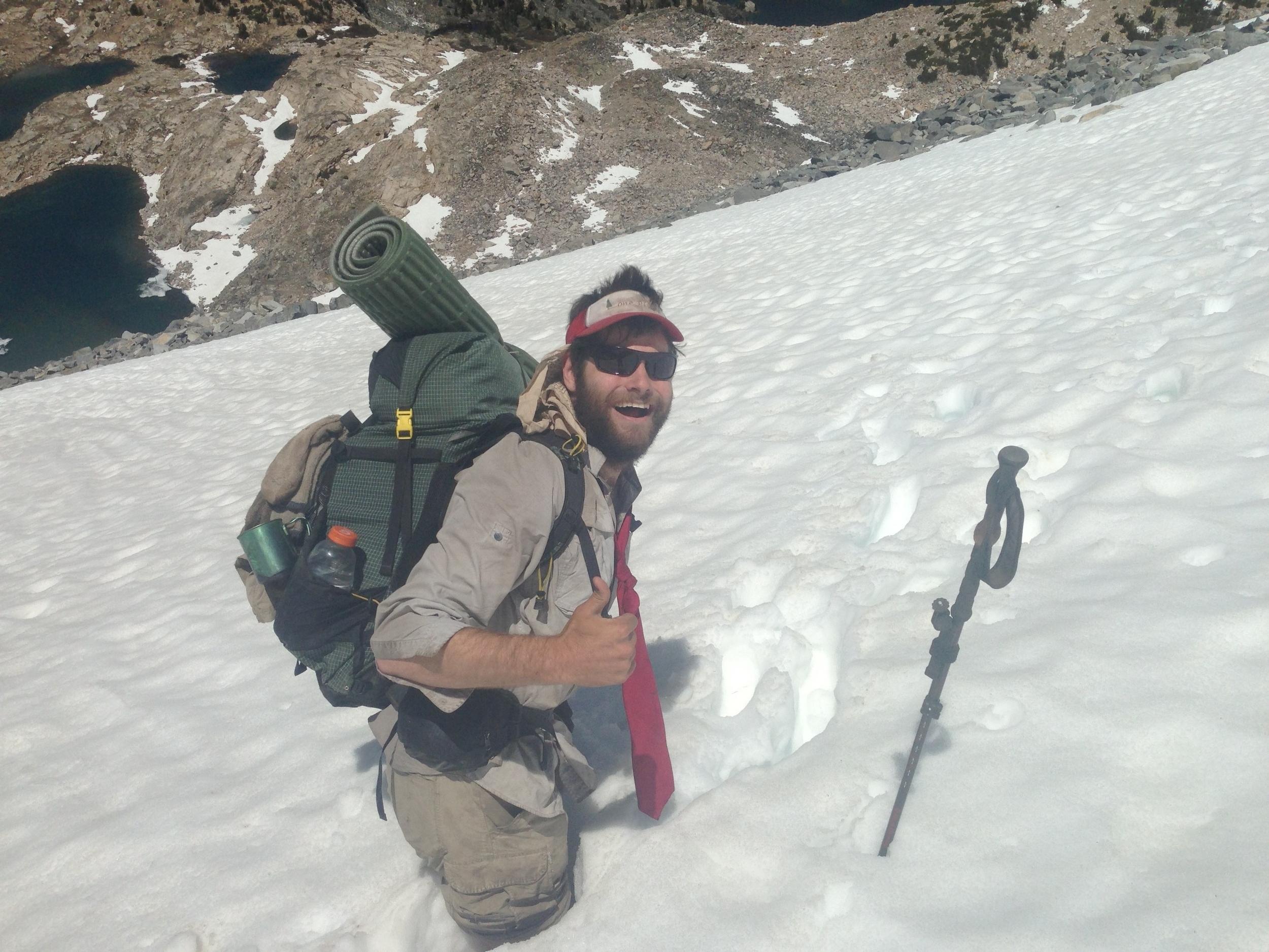 Here I am mid posthole high in the Sierra Nevada mountain range.