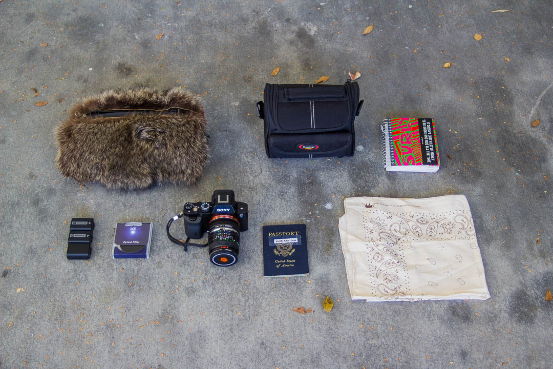 This handlebar bag is made from a roadkill raccoon salvaged from the side of the road.