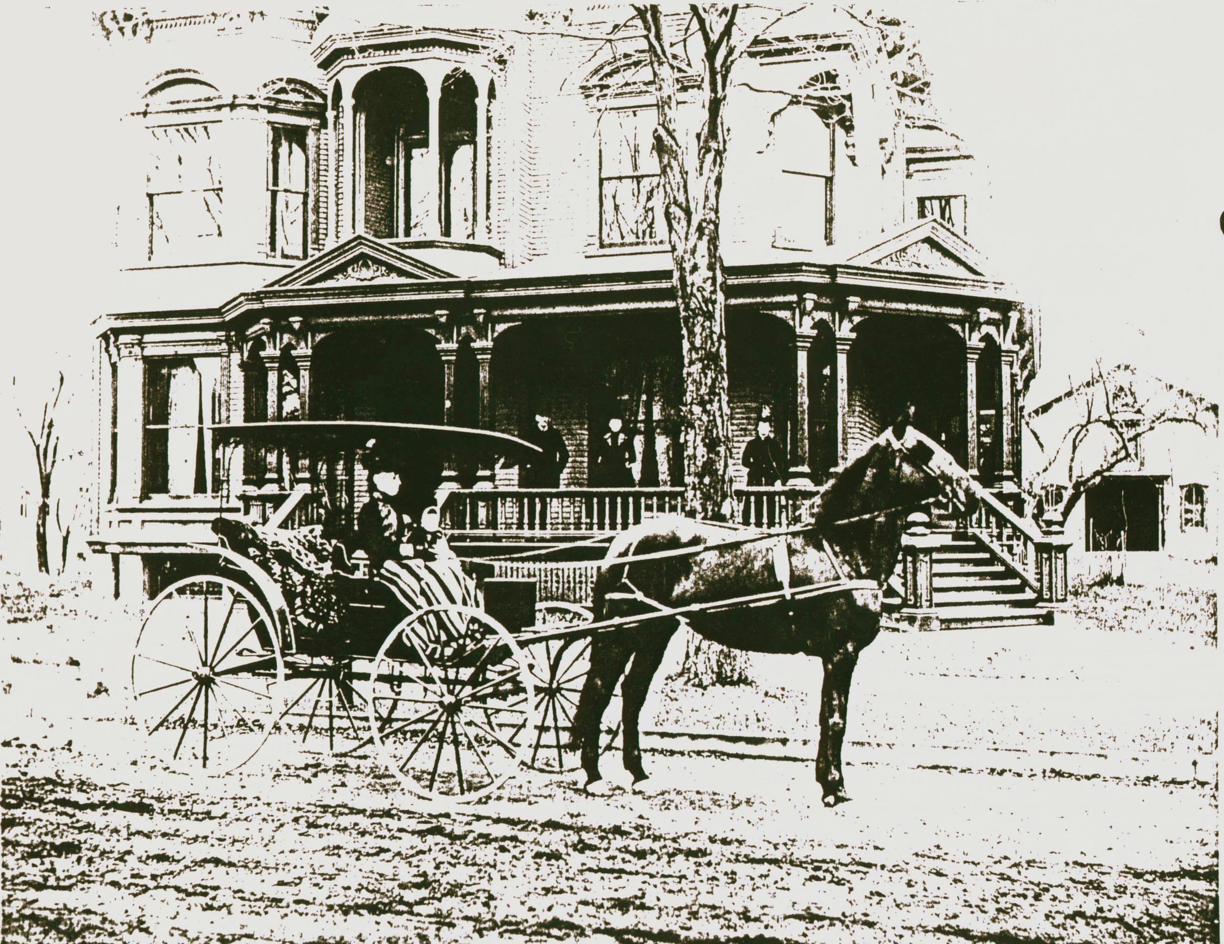 Mrs. Burritt on Horse in Front of House.jpg