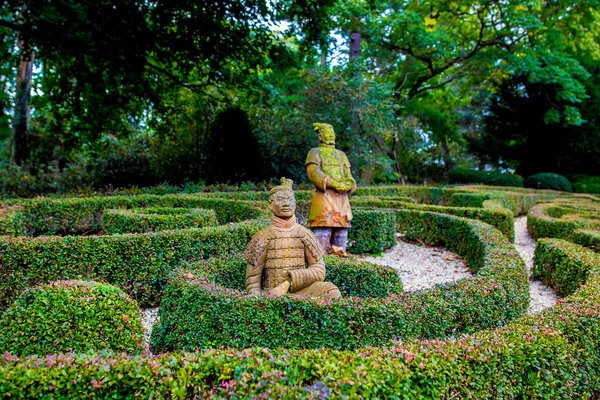 Asian terra cotta warrior statues grace the sculpted rear garden at the home of Tahamtan Ahmadi and Parisa Abdollahi in Rydal, Pennsylvania. (JEFF FUSCO / For the Philadelphia Inquirer)