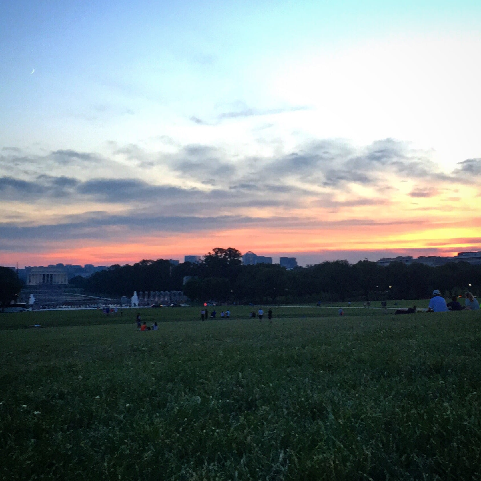 Relaxing on the DC mall, watching the sun set over Lincoln's head.