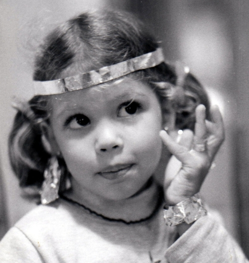 The artist at age 4 making jewelry using tin foil circa 1977
