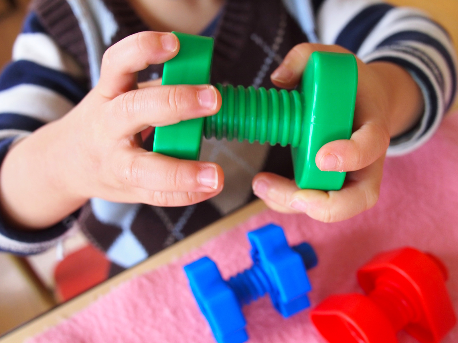 Hand-eye coordination and motor skills are a main focus at this level.