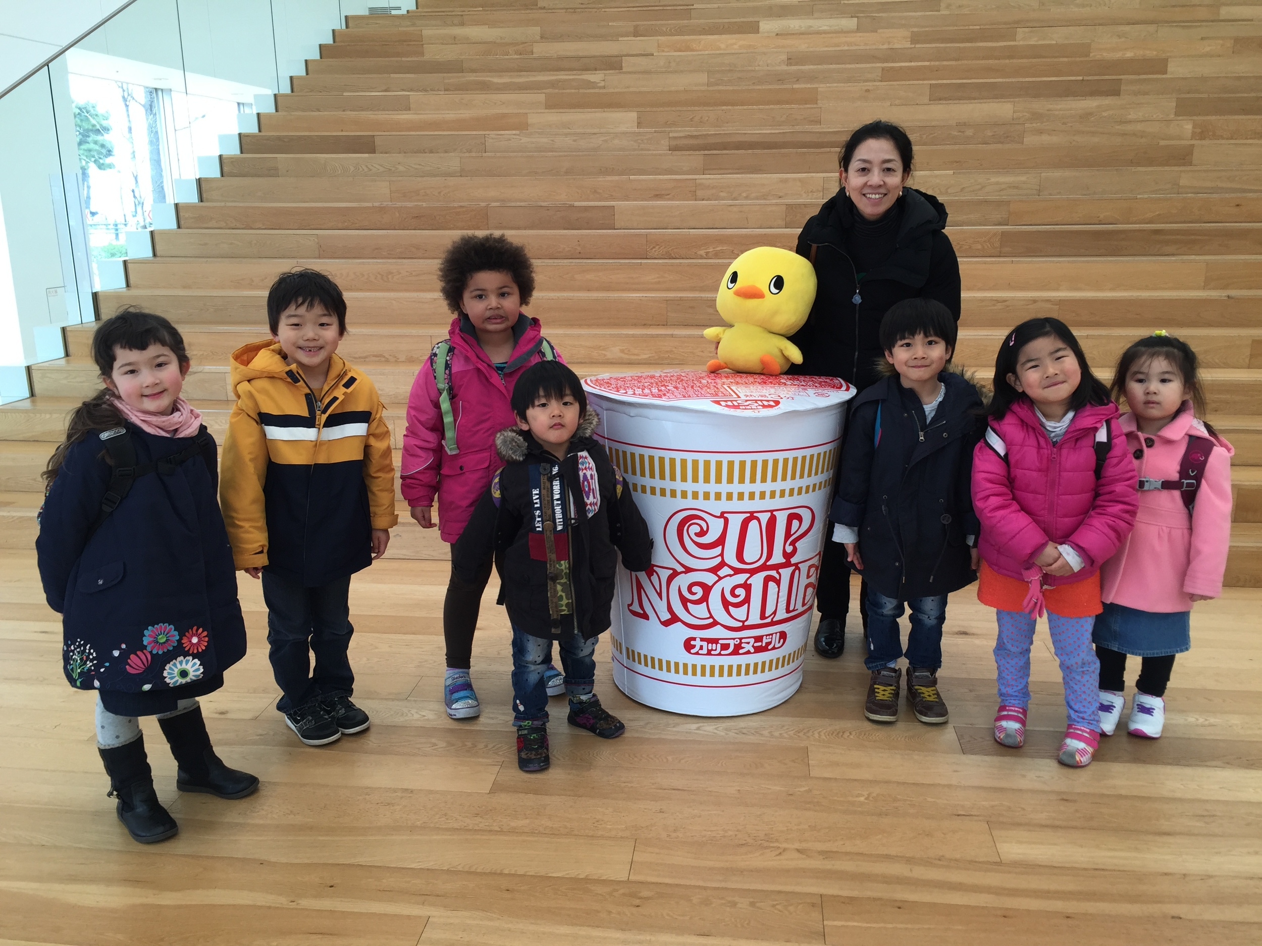 Happy children posing with the giant cup.