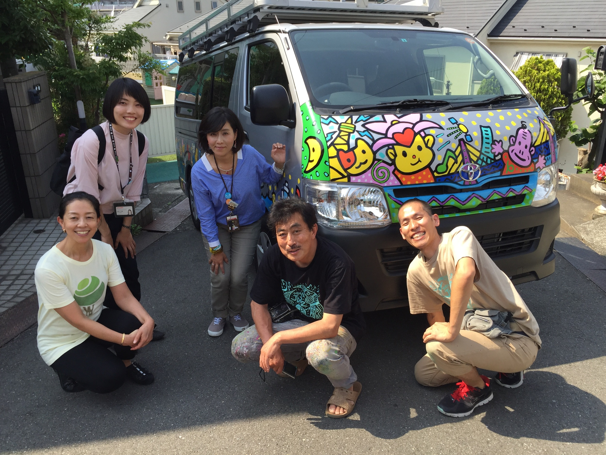 All of us, the J:COM crew and Treehouse teachers, in front of the travelling van.