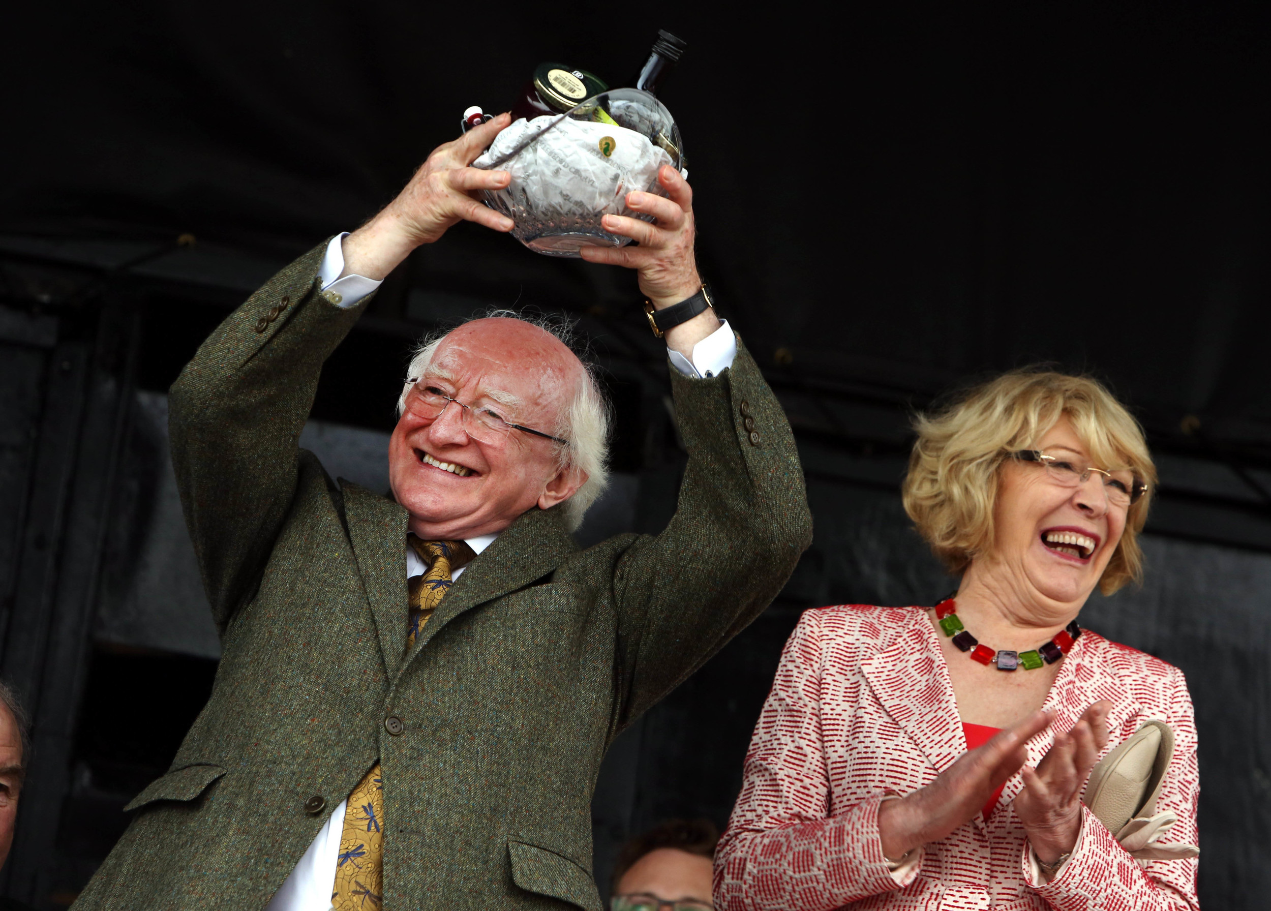 President Michael D Higgins with his wife Sabina, on receiving a gift at the ploughing championships