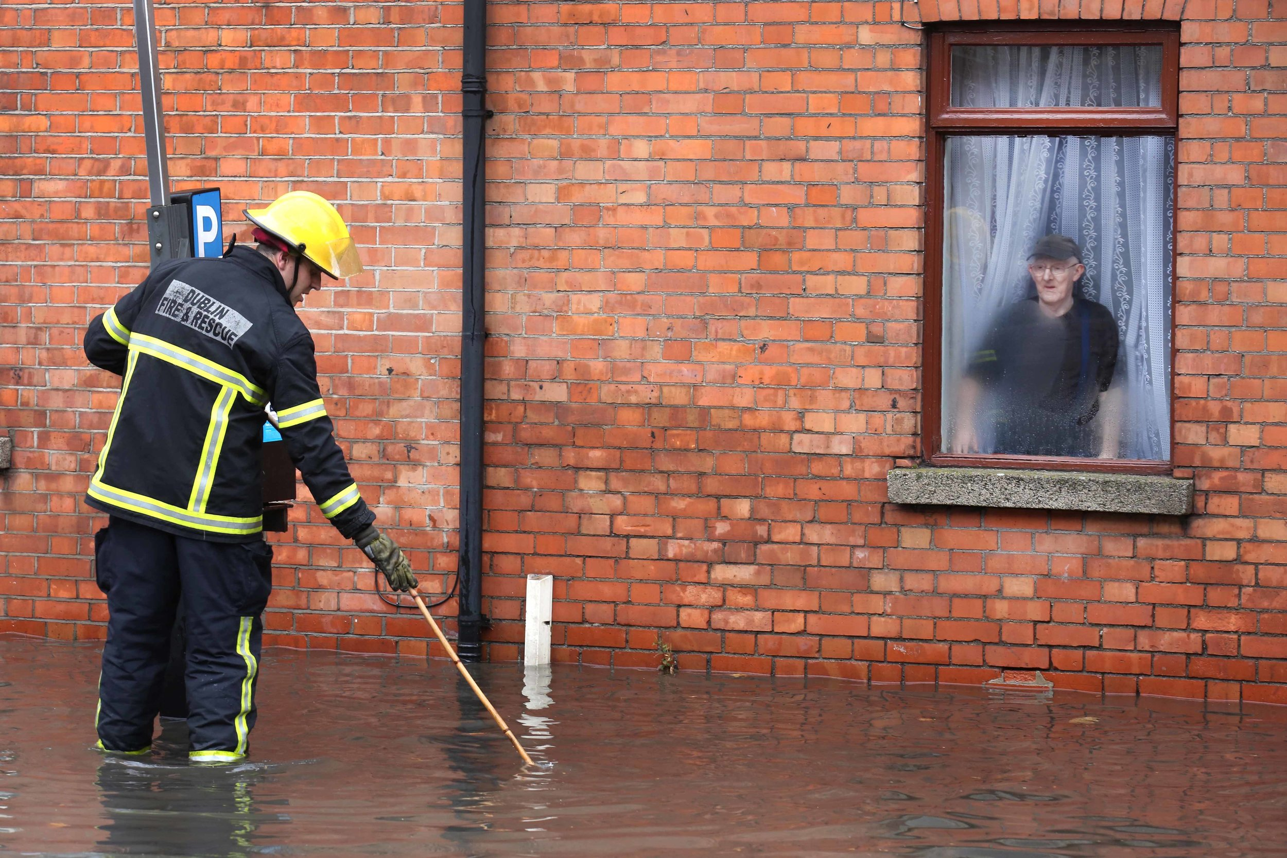 An elderly man is flooded into his home in Mount Brown Dublin
