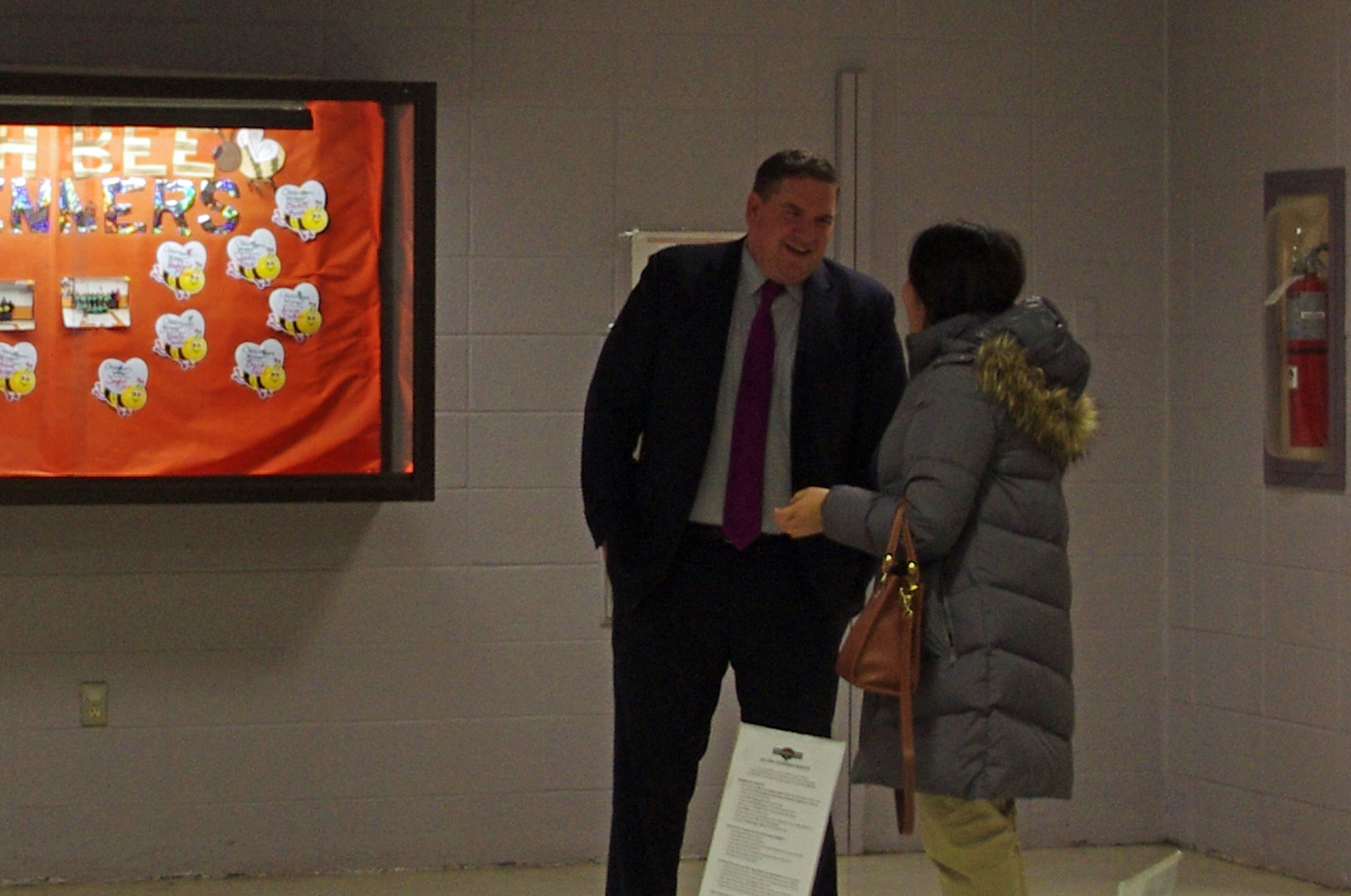 Principal Bill Black of West Broadway Middle School catches up with a neighbor
