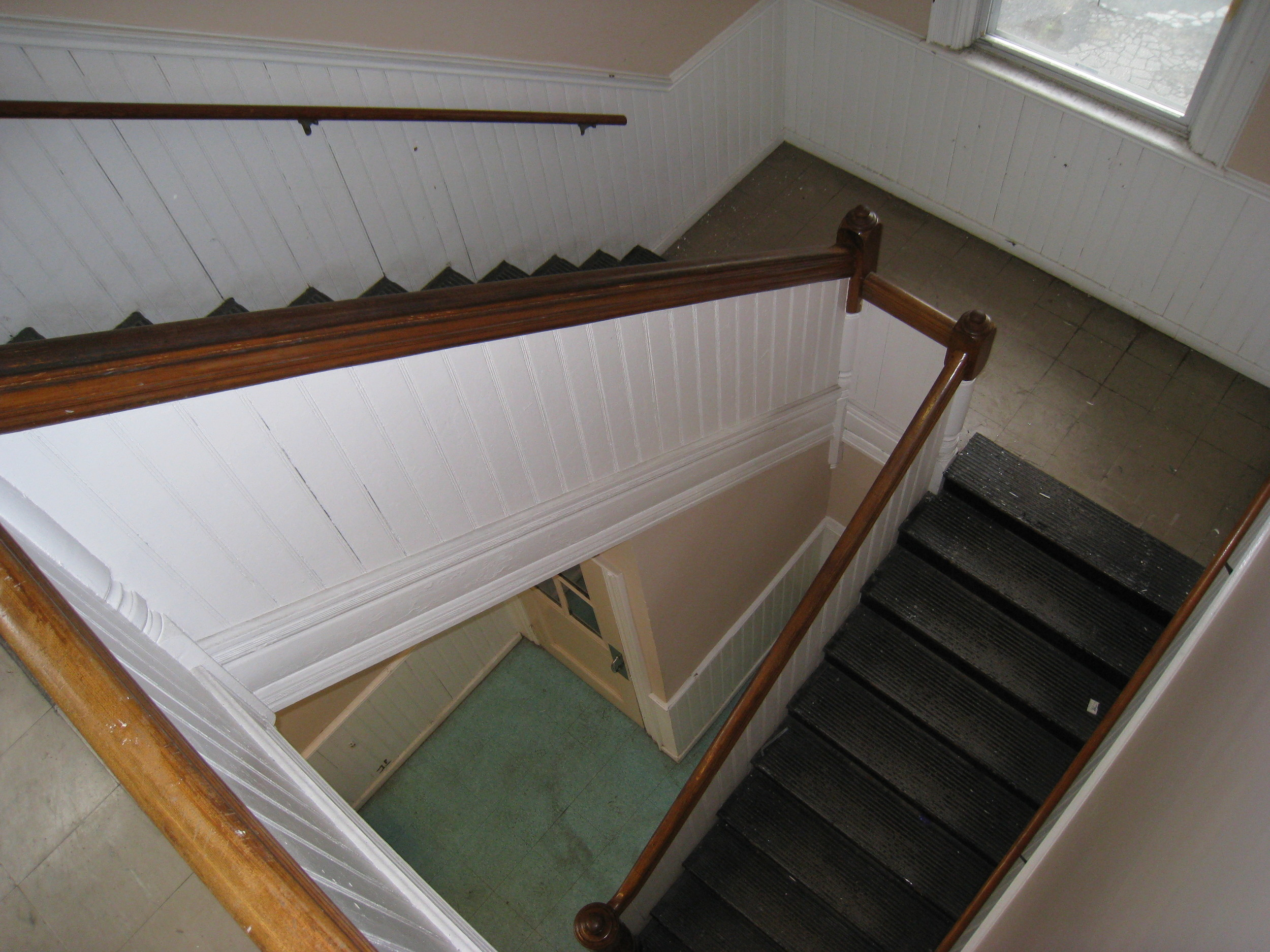 Original staircase and beadboard wainscoting. Photo credit: Providence Revolving Fund