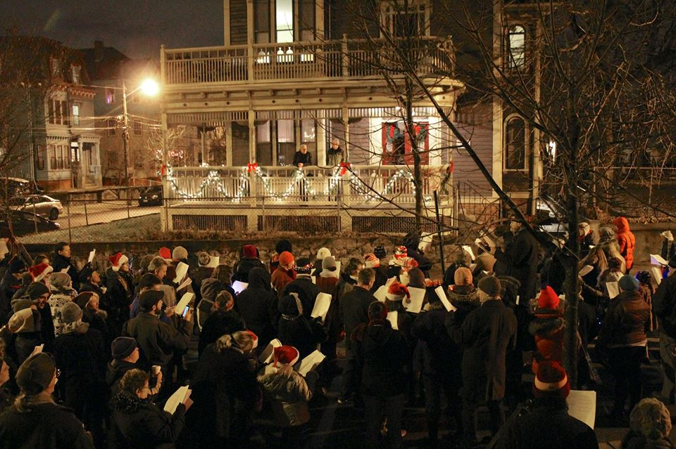 Carolers find an audience on a pretty porch on Messer Street (2014)  Photo Credit: Elaine Collins