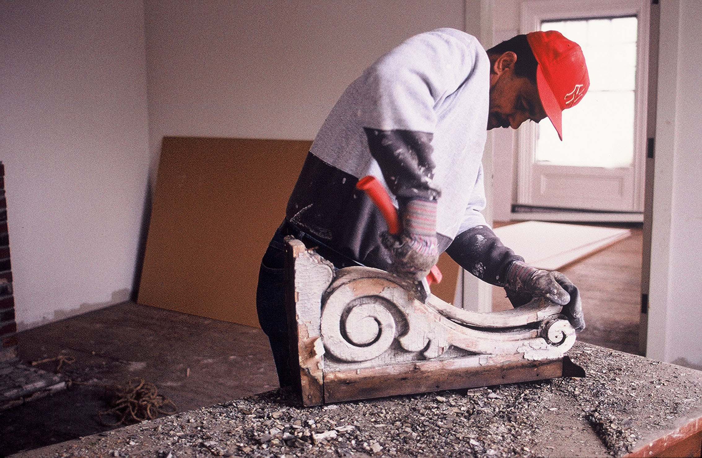 Restoring one of many elaborate cornice brackets, 2002  Photo credit: Clark Schoettle, Providence Revolving Fund